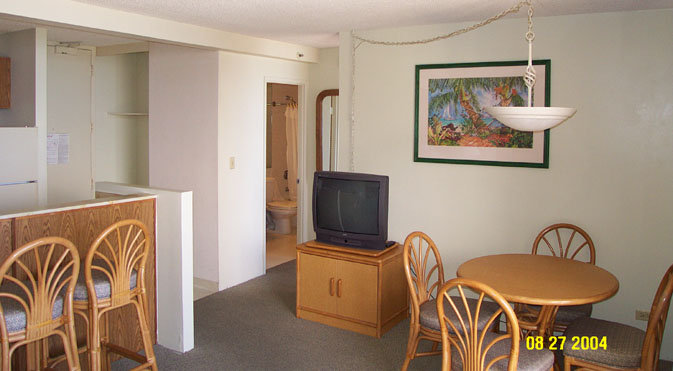 Dining area, large screen TV, and into the separate bathroom.